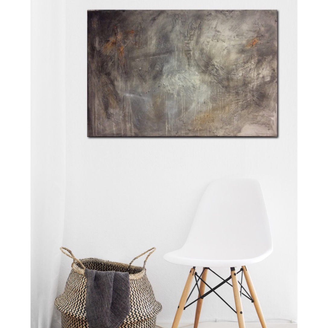 Interior design: Abstract textured painting in grey and a touch of orange