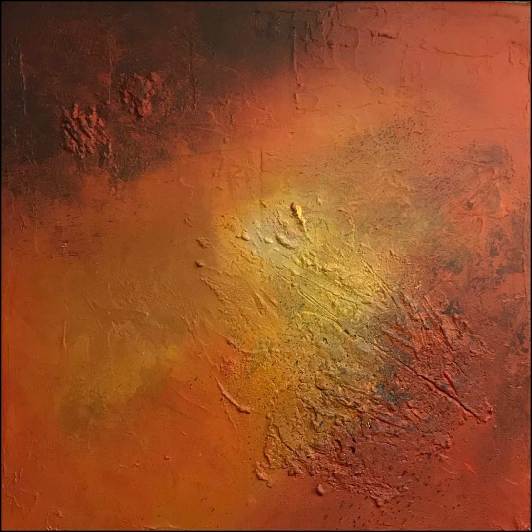 Textured abstract painting in warm colors