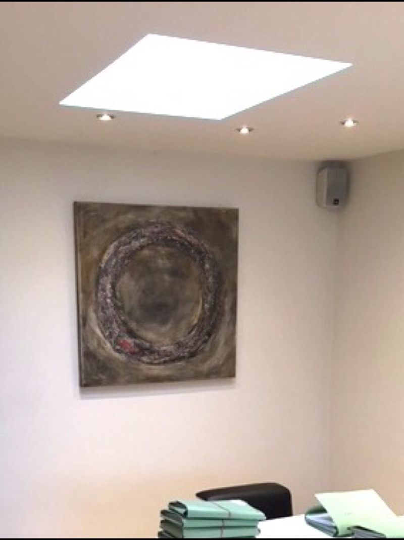 Interior design: Square textured abstract painting - circle in brown and a touch of red