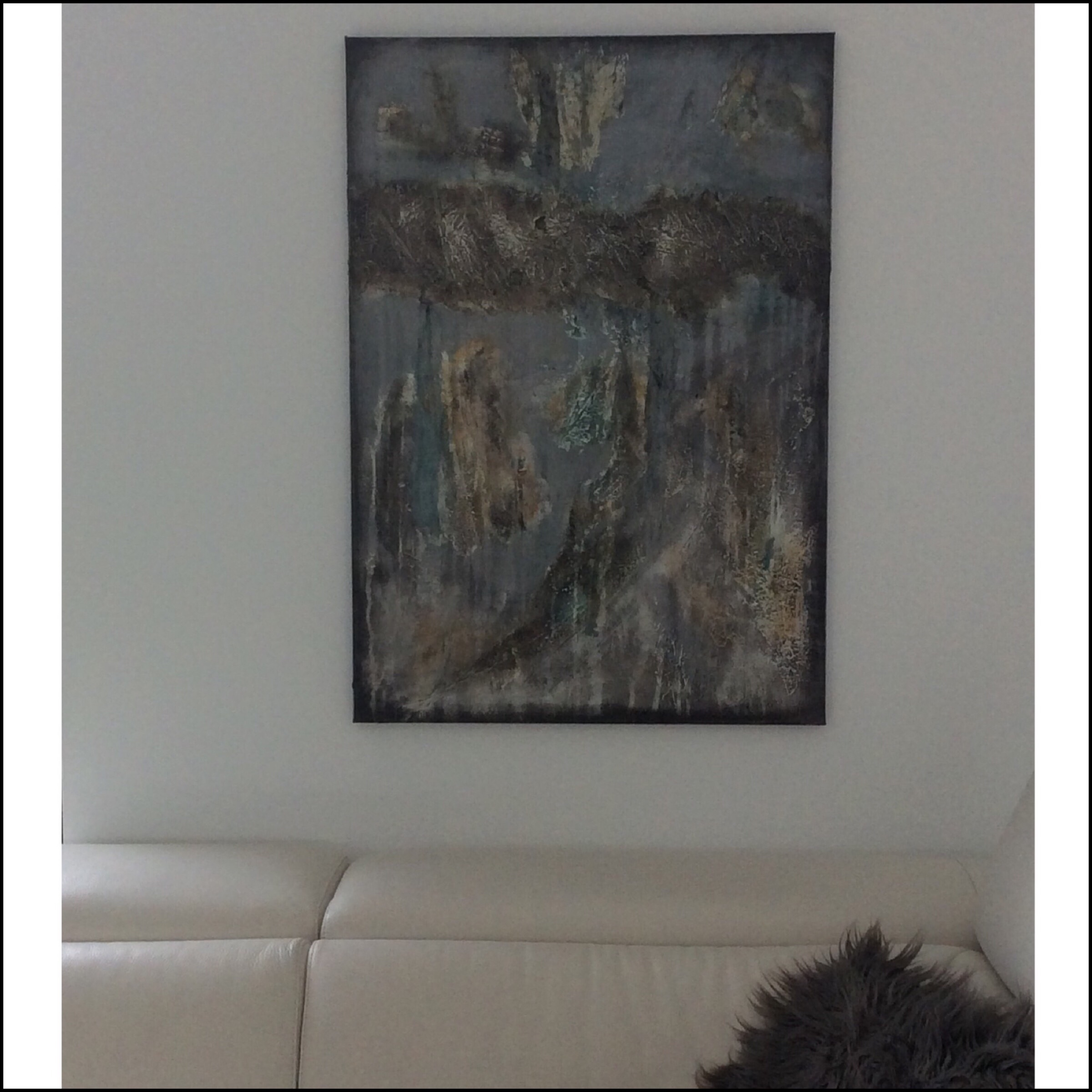 Interior design: Textured abstract painting in grey and an unusual kind of green
