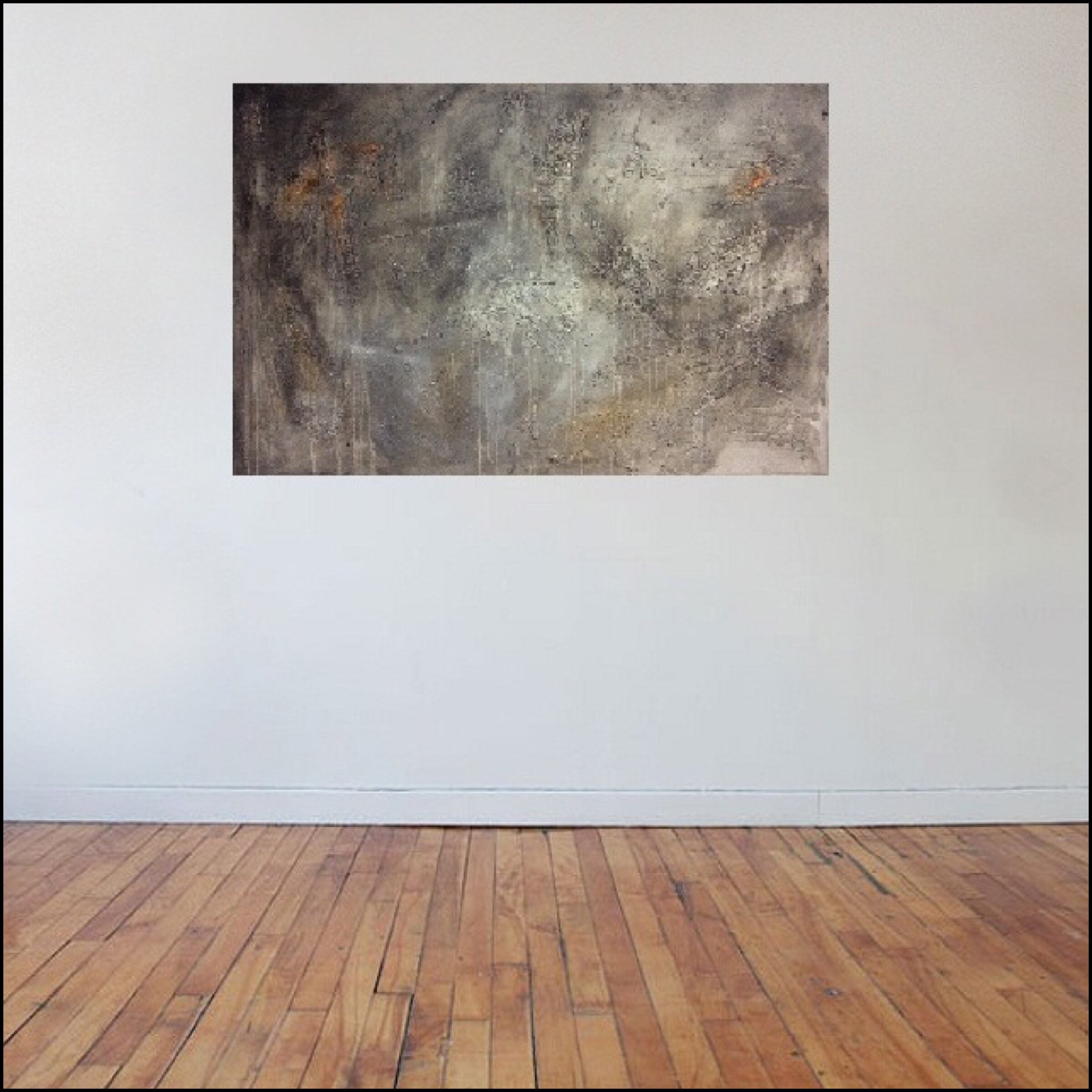 Interior design: Textured abstract painting in grey and a touch of orange