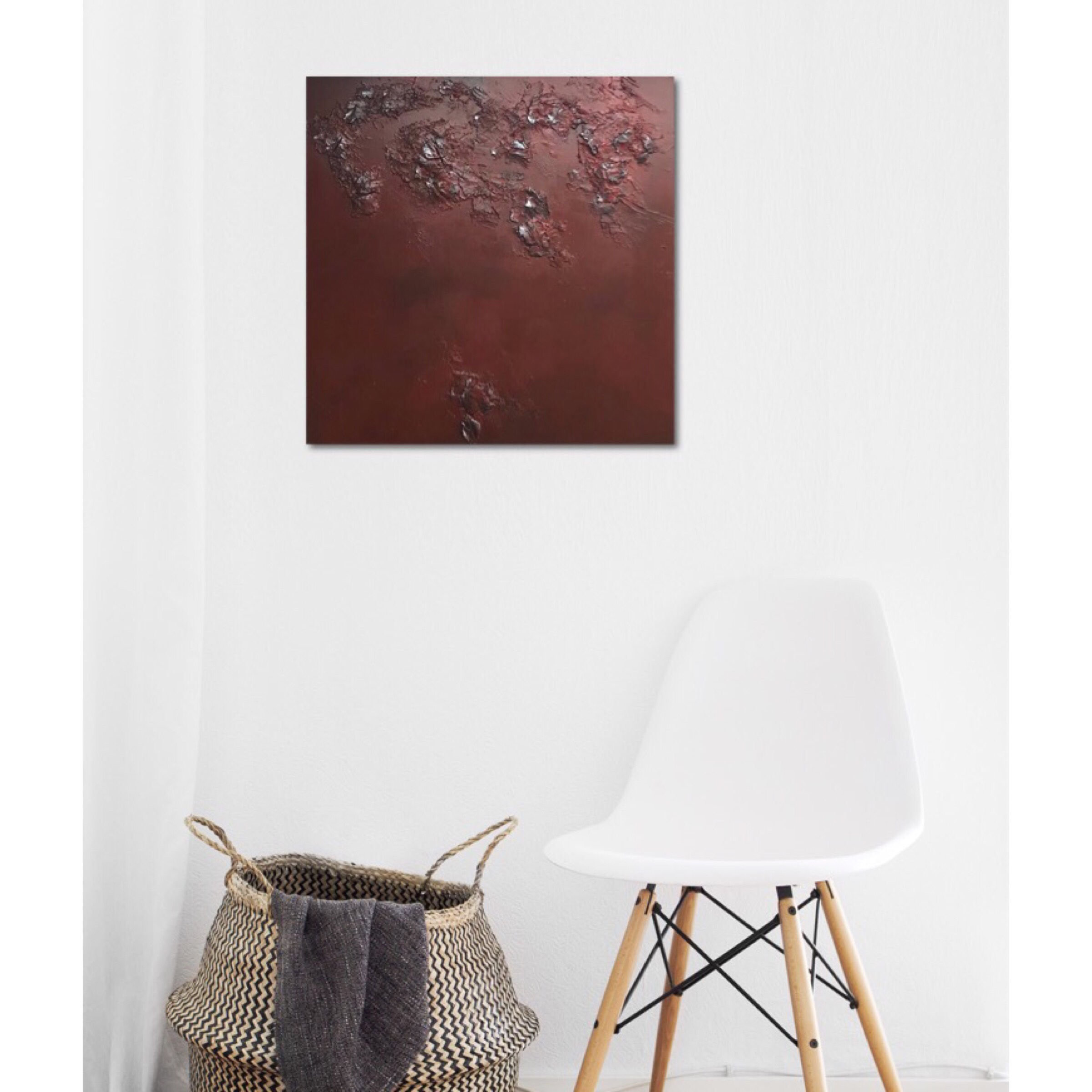 Interior design: Textured abstract painting in red and a touch of silver
