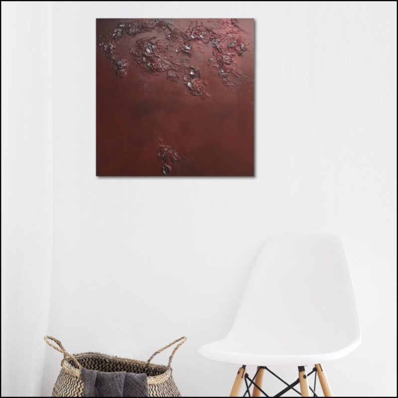 Textured abstract painting in red and a touch of silver